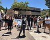 Protesters gather at the One American News Netw...