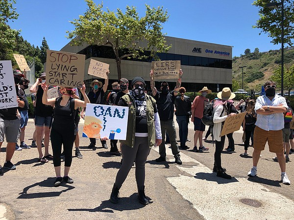 Protesters gather at the One American News Network (OAN) ...
