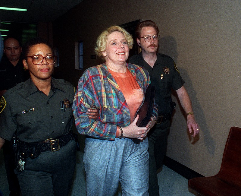 Betty Broderick led by officers in the downtown San Diego County Courthouse o...