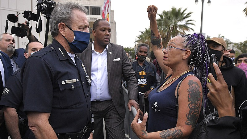 Los Angeles Police Department Chief Michel Moore speaks to a protester after ...