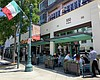 Customers sit in an outdoor dining area on Indi...