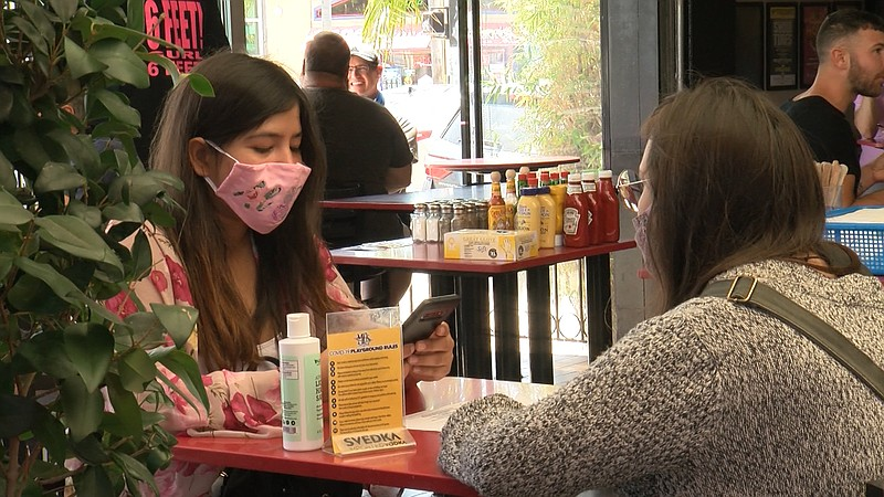 Two women sit down for a socially distanced lunch inside Urban Mo's in Hillcr...