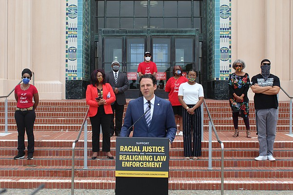 San Diego County Supervisor Nathan Fletcher speaks at a p...