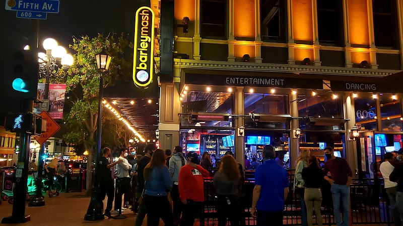 Patrons waiting to enter Barley Mash in downtown San Diego on June 20, 2020.