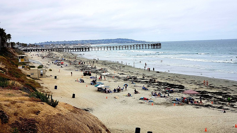 People on the beach on June 21, 2020, Pacific Beach overlooking Crystal Pier.