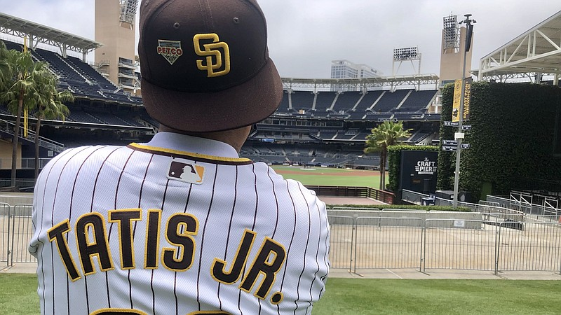 Ramon Chavez Torres watches San Diego Padres players taking batting practice ...
