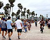 People on the Mission Beach boardwalk on June 2...