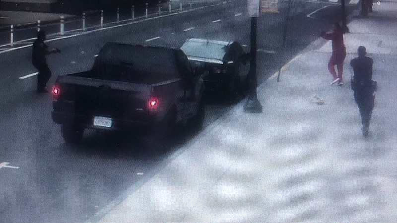 A still of a surveillance camera video from a business released by the San Di...