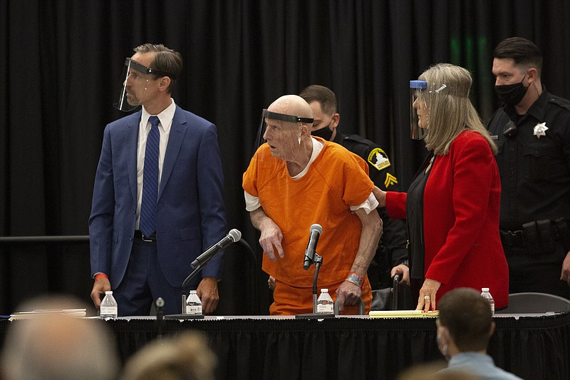 Joseph James DeAngelo, center, charged with being the Golden State Killer, hi...