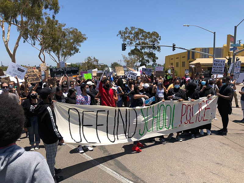 Students protest in front of San Diego Unified School District headquarters o...
