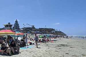 Photo for Large Crowds Fill San Diego County Beaches As Holiday Weekend Begins