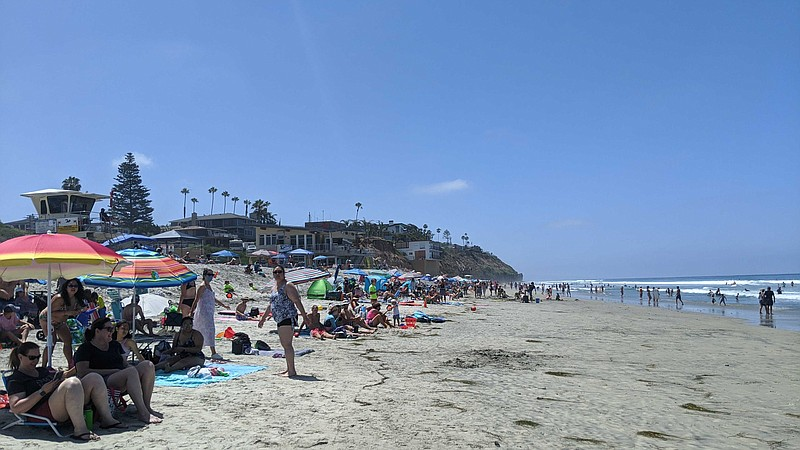 Crowds gather at Moonlight State Beach in Encinitas, California. July 3, 2020.