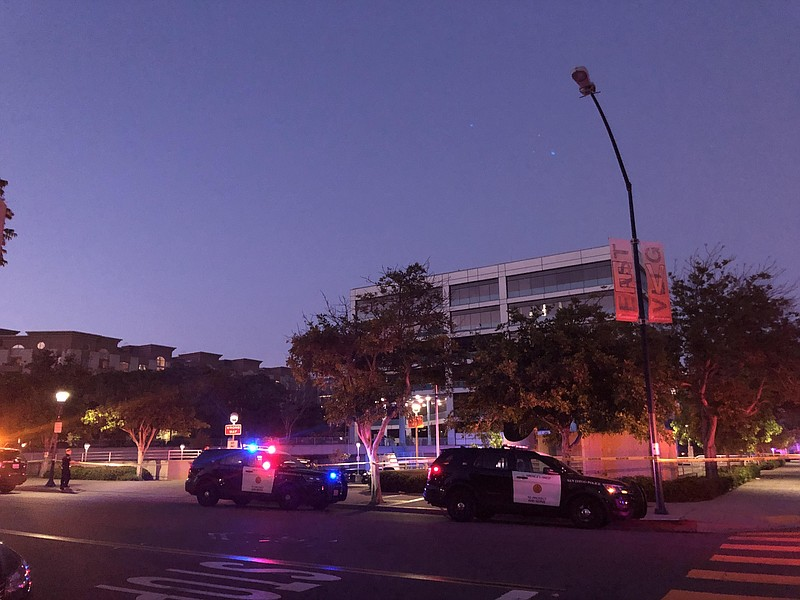 Police cars are parked outside of San Diego Police Department headquarters fo...