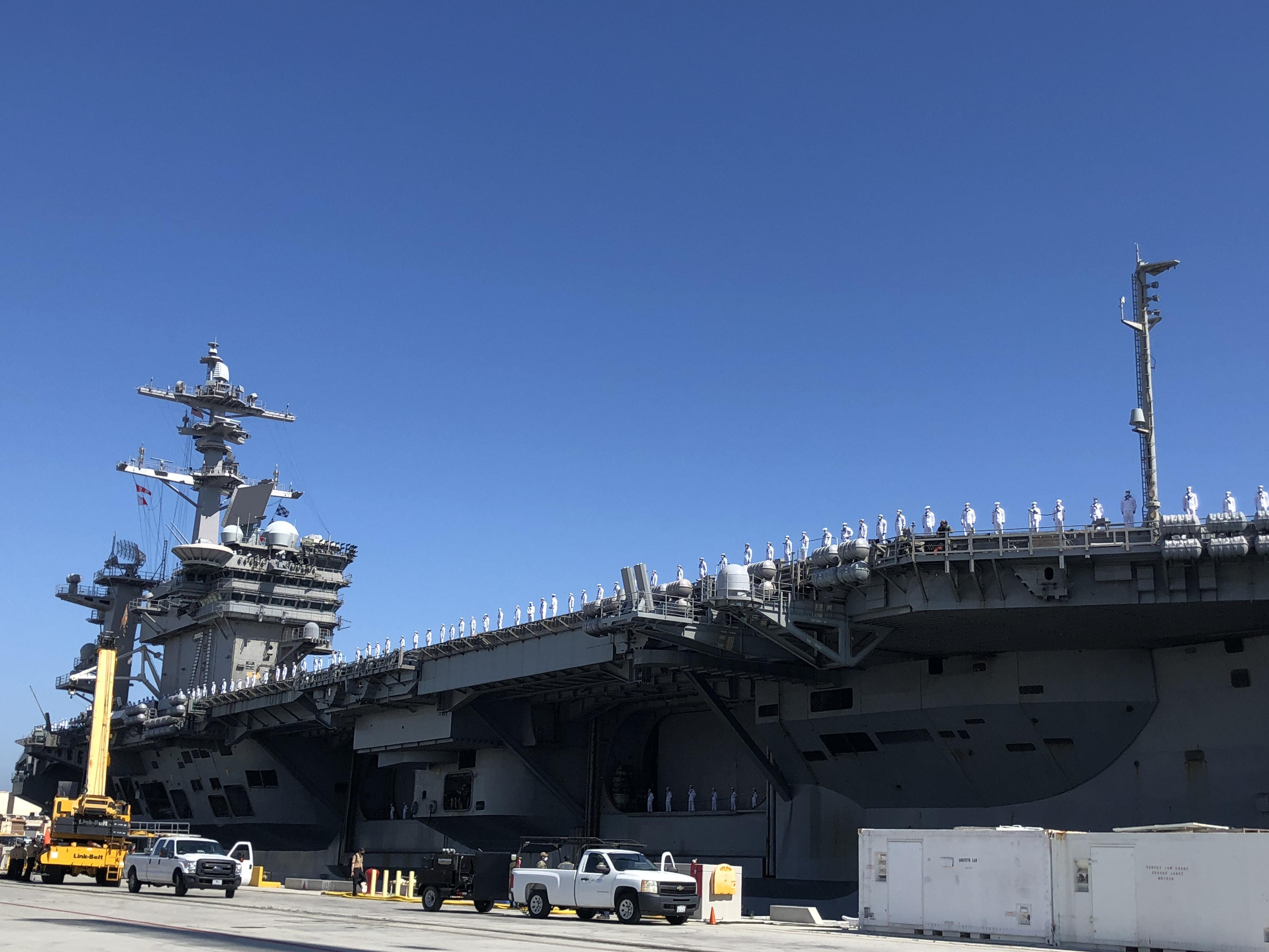 Navy carrier sidelined by virus returns home to San Diego