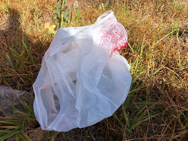 Thin single-use plastic bags, like this one in Mission Valley, litter roadsid...
