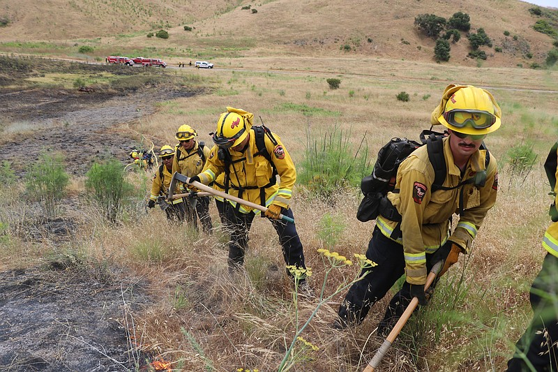 Cal Fire firefighters train at Camp Pendleton Fire School, an annual exercise...