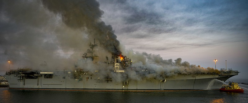 Smoke rising from the USS Bonhomme Richard fire at Naval Base San Diego, July...