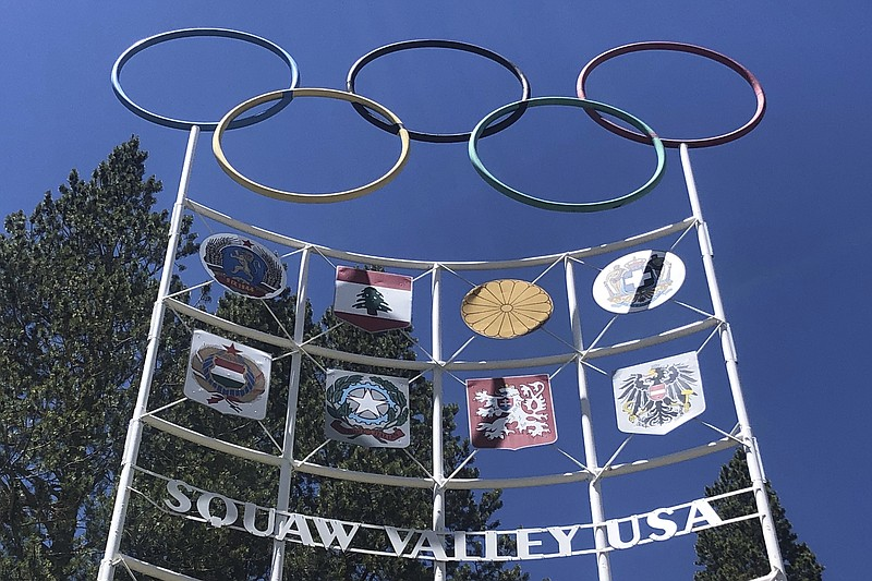 The Olympic rings stand atop a sign at the entrance to the Squaw Valley Ski R...
