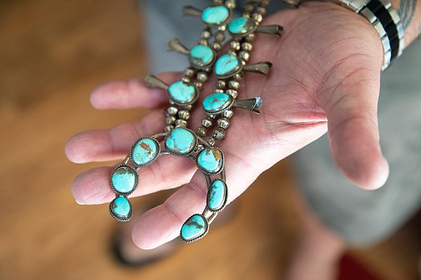 Michael Weiss holds a necklace made by his mother, Mona W...