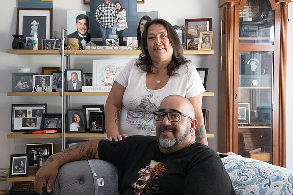 Tina and Michael Weiss are shown in their Chula Vista hom...