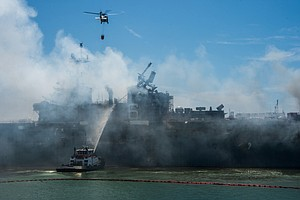 Photo for Crews Battle Blazing Heat As Fire Continues For Third Day Aboard Navy Ship