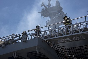 Photo for Crews Make Progress Against Fire On Ship At San Diego Naval Base