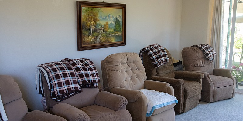 Empty chairs are shown in the living area of Aury's Home Care in Chula Vista ...