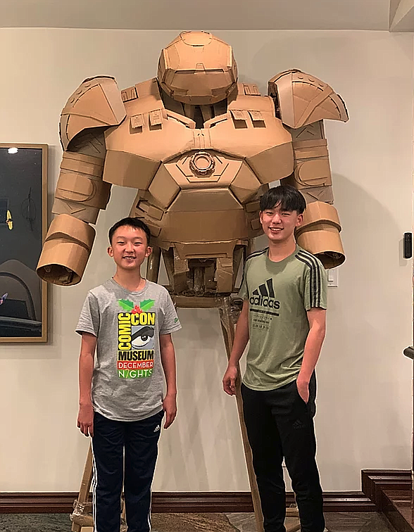 Bauer and Connor Lee with their current Cardboard Superhe...