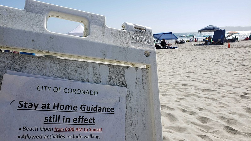 A sign at Coronado beach on July 12 telling residents the city's stay-at-home...
