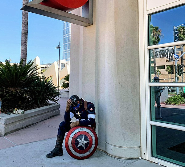 Captain America (cosplayer Shawn Richter) registers how m...