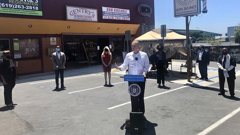 Mayor Kevin Faulconer at Gentry's Beauty and Barber Headquarters on July 29, ...