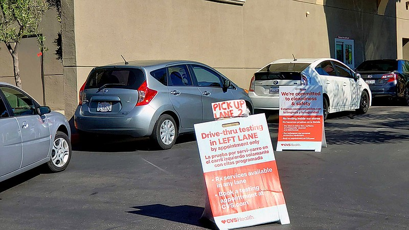 Cars lining up for drive-thru COVID-19 testing at a CVS Pharmacy in Chula Vis...