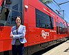 MTS CEO Sharon Cooney stands in front of a trol...