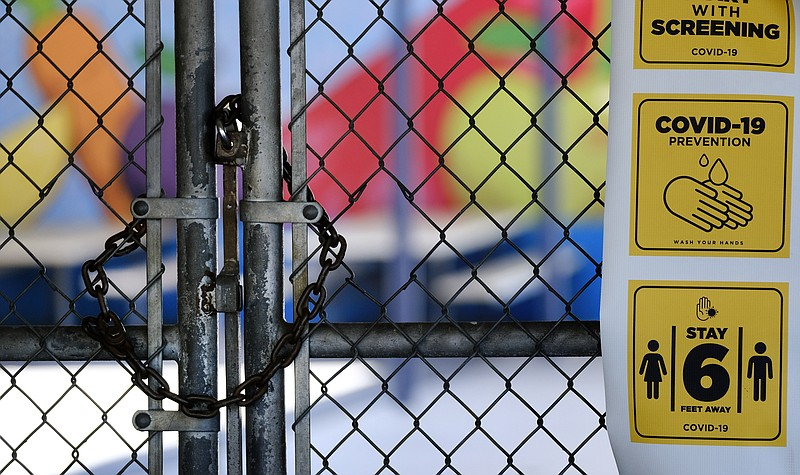 In this July 13, 2020, file photo, a gate is locked at the closed Ranchito El...