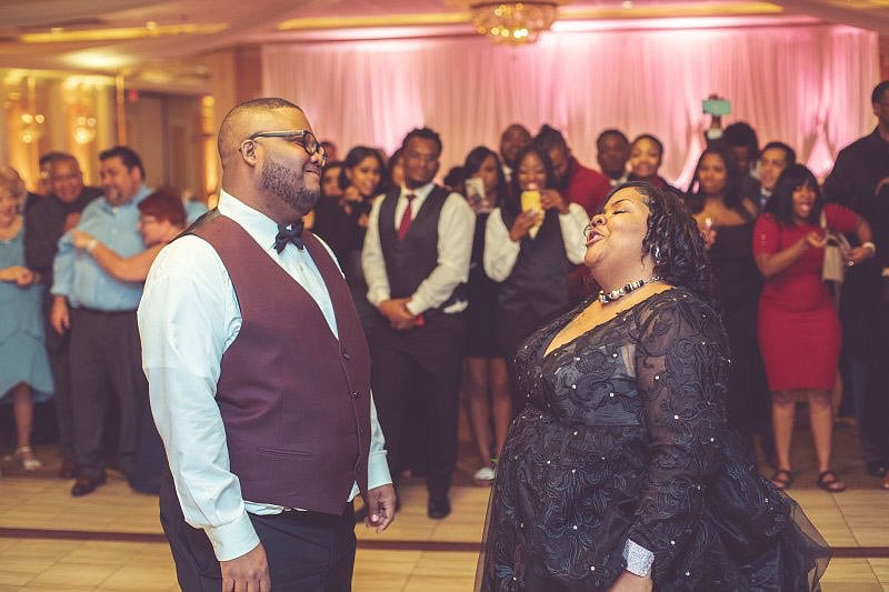 Tavi McNeil and his mother, Juliet Davis, sing and dance together in an undat...
