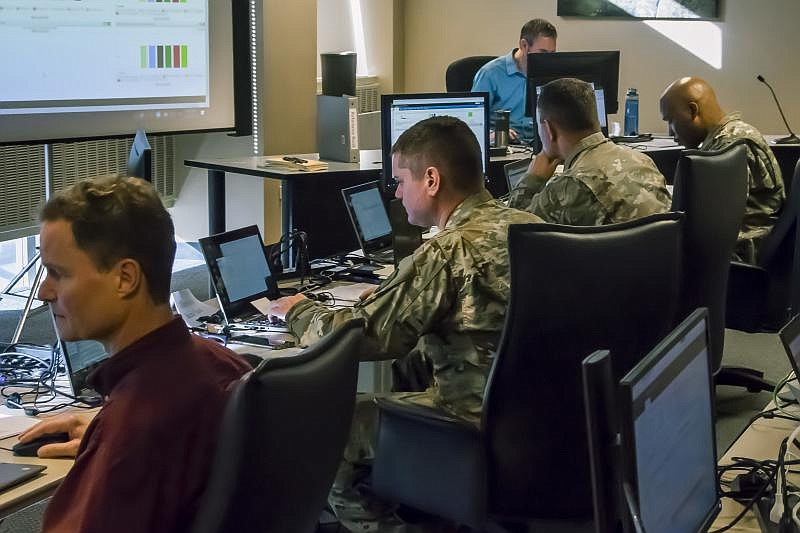 Members of the Colorado National Guard help monitor network traffic and advis...