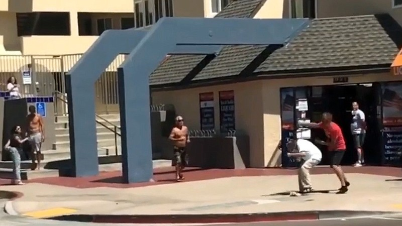 A Black journalist being sucker-punched by a man while covering a Black Lives...