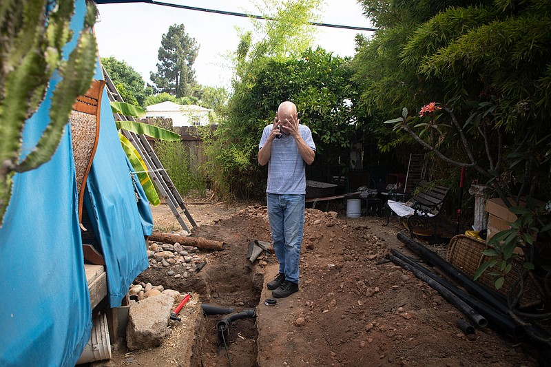 John Sewell-Thurston expresses frustration while showing new trenches dug for...