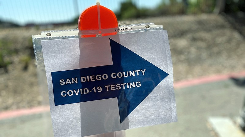 A sign outside the county's walk-up testing site at the Tubman Chavez Communi...
