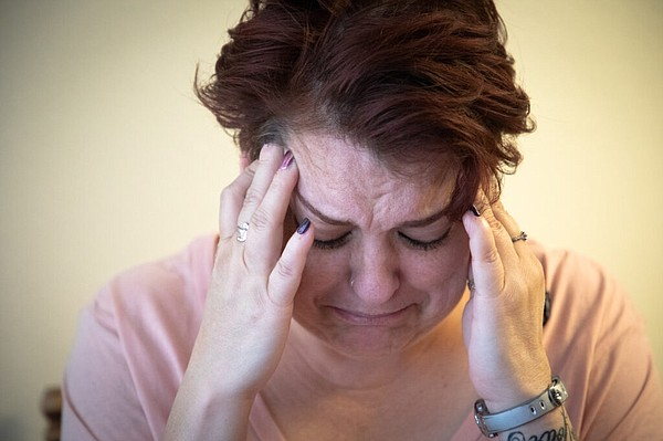 Army veteran AJ Williams becomes distressed as she discus...