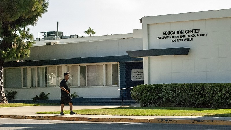 A man walking by the Sweetwater Union Hgh School District Education Center in...
