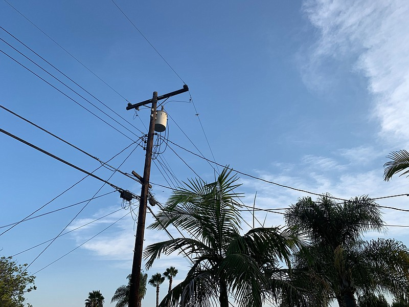 Power lines strung above a neighborhood in San Carlos, Aug. 18, 2020.