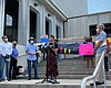 Community and climate change activists gather o...