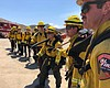 A CalFire hand crew prepares for a midday hike ...