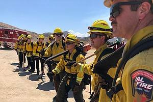 Photo for COVID-19 Adds To The Heat Of Battling Wildfires