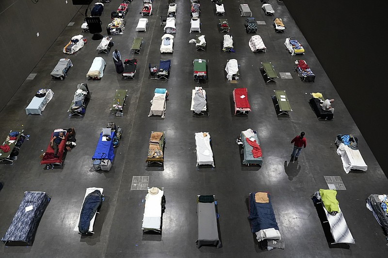 Beds fill a homeless shelter inside the San Diego Convention Center Tuesday, ...