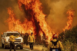 Photo for Crews Keep Working To Pen In Huge California Wildfires