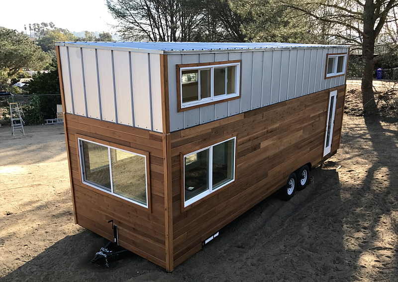 This is an example of a moveable tiny home sold by Zen Tiny Homes pictured in...