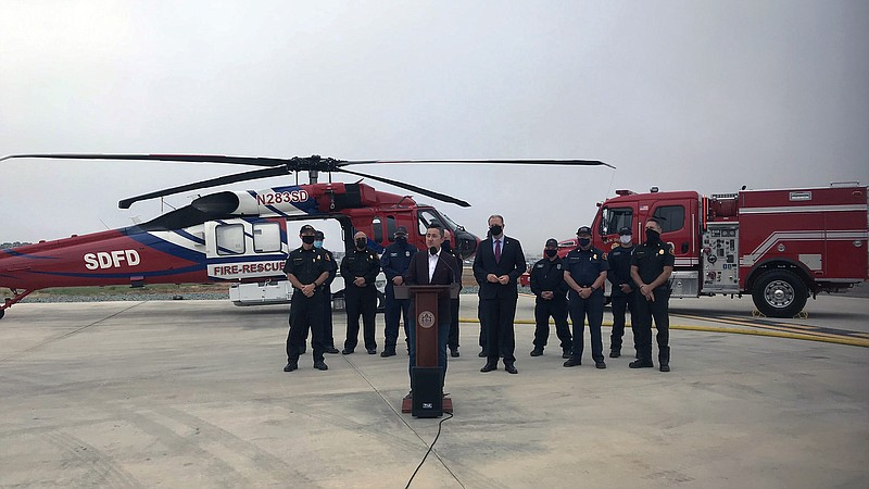 Councilmember Chris Cate, Mayor Kevin Faulconer and San Diego Fire Chief Coli...