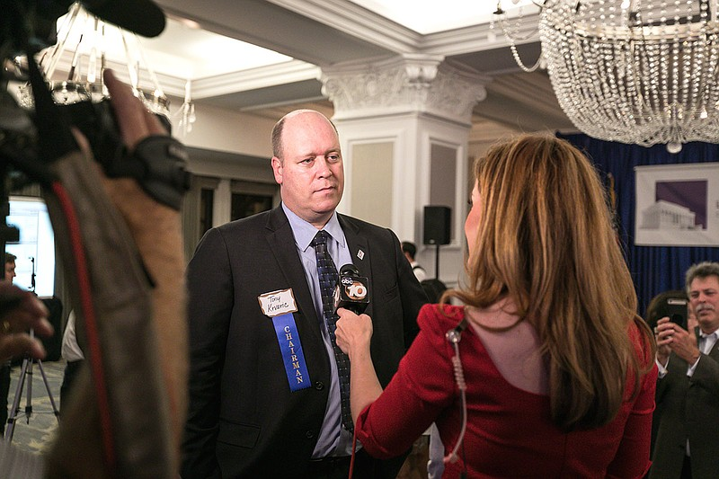 San Diego County Republican Party Chair Tony Krvaric speaks to a reporter at ...